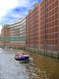 Boats Pass by Waterfront Warehouses and Lofts, Speicherstadt Warehouse District, Hamburg, Germany Photographic Print by Miva Stock