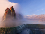 Fly Geyser with Snow Capped Granite Range in the Black Rock Desert Near Gerlach, Nevada, USA Photographic Print by Chuck Haney
