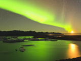 Aurora Borealis and Moon over Icebergs, Jokulsarlon and Breidamerkurjokull, Iceland Stampa fotografica di Tom Norring