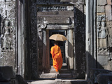 Monk with Buddhist Statues in Banteay Kdei, Cambodia Photographic Print by Keren Su