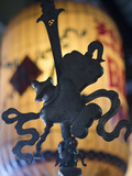 Metal Icon in a Buddhist Temple in Hoi An, Vietnam Photographic Print by David H. Wells