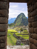 View Through Window of Ancient Lost City of Inca, Machu Picchu, Peru, South America with Llamas Reprodukcja zdjęcia autor Miva Stock