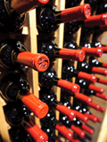 Wine Bottles in a Rack, Temecula, California, USA Photographic Print by Richard Duval
