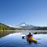 A Woman in a Sea Kayak Paddles on Trillium Lake, Oregon, USA Photographic Print by Gary Luhm