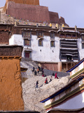 Tibetan Pilgrims Climbing to a Temple in Palkhor Monastery, Gyantse, Tibet, China, Asia Photographic Print by Nancy Brown