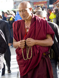 Monk in Barkor Street in Lhasa, Tibet, China, Asia Photographic Print by Nancy Brown