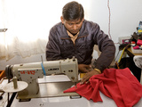 Young Male Nepali Factory Worker Sewing a Fleece at a Sewing Machine in a Factory, Kathmandu, Nepal Photographic Print by Phil Clarke-Hill