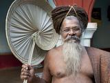Joranda Monk Wearing Tree Bark Cloth, Holding Palm Leaf Fan, Joranda, Orissa, India Photographic Print by Annie Owen