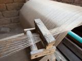 Silk Thread Being Spun on Large Handmade Wooden Wheel, Rural Orissa, India, Asia Photographic Print by Annie Owen