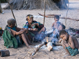 Jul'Hoan !Kung Bushmen Family around a Fire in their Village, Bushmanland, Kalahari Desert, Namibia Photographic Print by Kim Walker