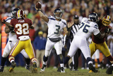 NFL Playoffs 2013: Seahawks vs Redskins - Russell Wilson Print by Evan Vucci