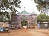 Ascetics Walking Through Entrance to Joranda Monastery Complex, Joranda, Orissa, India Photographic Print by Annie Owen