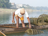 Fisherman in Wooden Boat Checking Fishing Pots Made of Coir and Bamboo, River Mahanadi, India Photographic Print by Annie Owen