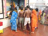 Hindu Pilgrims Worshipping at Ganesh Shrine in Hariharnath Temple, Sonepur, Bihar, India Photographic Print by Annie Owen