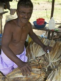 Market Stall Holder Selling Dried Fish, Nilaveli, Trincomalee, Sri Lanka, Asia Photographic Print by Peter Barritt