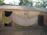 Cotton Sari Being Hung Out to Dry across Village House Wall, Rural Orissa, India, Asia Photographic Print by Annie Owen