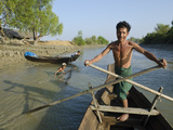 Fisherman on His Small Boat, Yin Dee Lag Village, Irrawaddy Delta, Myanmar (Burma), Asia Photographic Print by Eitan Simanor