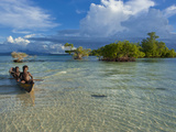 Young Boys Fishing in the Marovo Lagoon Below Dramatic Clouds, Solomon Islands, Pacific Photographic Print by Michael Runkel