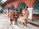 Barefoot Joranda Monks Wearing Orange Cloths in a Monastery Building, Joranda, Orissa, India, Asia Photographic Print by Annie Owen