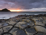 Sunset over the Giants Causeway, UNESCO World Heritage Site, County Antrim, Northern Ireland, UK Photographic Print by Adam Burton