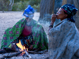 Jul'Hoan !Kung Bushman, Two Women Smoke around Fire in Village, Bushmanland, Namibia Photographic Print by Kim Walker