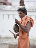 Joranda Monk at Dusk Sounding a Cymbal for Ritual Evening Prayer, Joranda, Orissa, India Photographic Print by Annie Owen
