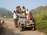 Overloaded Village Jeep Carrying Dunguria Kondh Tribesmen, Bissam Cuttack, Orissa, India Photographic Print by Annie Owen