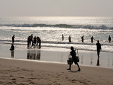Puri Beach on Bay of Bengal, Indian Families Relaxing and Paddling, Puri, India Photographic Print by Annie Owen