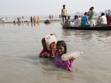 Mother and Daughter Wading across River Ganges Holding Bottles of Holy River Water, Sonepur, India Photographic Print by Annie Owen