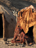 Himba Woman Sitting Outside Her Hut, Purros Village, Northern Kaokoland, Namibia, Africa Photographic Print by Kim Walker