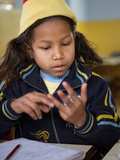 Female Young Rescued Nepali Child Doing Sums in Orphanage, Bhairawa, Nepal Photographic Print by Phil Clarke-Hill