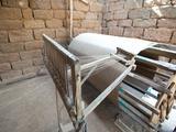 Silk Thread Being Spun on Large Wooden Handmade Wheel, Rural Orissa, India, Asia Photographic Print by Annie Owen