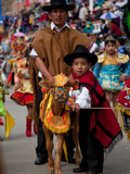 Young Boy and His Father with a Cow, Part of the Oruro Carnival Procession Parade, Oruro, Bolivia Photographic Print by Phil Clarke-Hill
