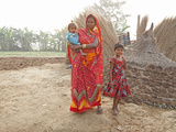 Mother in Red Sari and Her Two Children in Rural Bihari Village at Dawn, Sonepur, Bihar, Inda Photographic Print by Annie Owen
