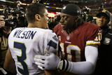 NFL Playoffs 2013: Seahawks vs Redskins - Robert Griffin III and Russell Wilson Photographic Print by Evan Vucci