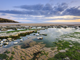 Sunset over Rocks and Pools at Dunraven Bay, Southerndown, Wales Photographic Print by Chris Hepburn