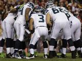 NFL Playoffs 2013: Seahawks vs Redskins - Russell Wilson Fotografisk trykk av Matt Slocum