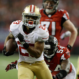 NFL Playoffs 2013: Falcons vs 49ers - LaMichael James Photographic Print by David Goldman