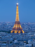 Illuminated Eiffel Tower, Viewed over Rooftops, Paris, France, Europe Photographic Print by Gavin Hellier