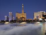 Bellagio Fountains Perform in Front of the Eiffel Tower Replica, Las Vegas, Nevada, USA Photographic Print by Gavin Hellier
