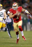 NFL Playoffs 2013: Packers vs 49ers - Colin Kaepernick Fotografisk trykk av Tony Avelar