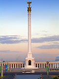 Bus Passing Kazakyeli Monument (Kazakh Country) at Dusk, Astana, Kazakhstan, Central Asia, Asia Photographic Print by Jane Sweeney