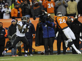 NFL Playoffs 2013: Ravens vs Broncos - Jacoby Jones and Rahim Moore Photographic Print by Jack Dempsey