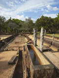 Remains of Monastic Refectory, Northern Ruins, Anuradhapura, UNESCO World Heritage Site, Sri Lanka Photographic Print by Ian Trower