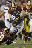 NFL Playoffs 2013: Seahawks vs Redskins - Marshawn Lynch Photographic Print by Matt Slocum
