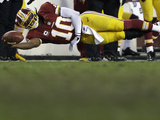 NFL Playoffs 2013: Seahawks vs Redskins - Robert Griffin III Photographic Print by Matt Slocum
