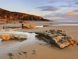Sunset over Rocks with Flowing Water at Dunraven Bay, Southerndown, Wales Photographic Print by Chris Hepburn