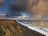 A Rain Cloud Approaches the Cliffs at Weybourne, Norfolk, England Photographic Print by Jon Gibbs