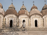 Woman with Broom Emerging from One of 108 Shiva Temples, Kalna, West Bengal, India Photographic Print by Annie Owen