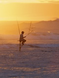 Stilt Fisherman at Weligama, South Coast, Sri Lanka Photographic Print by Peter Barritt